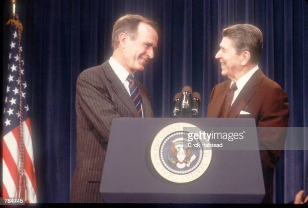 Vice President George Bush shakes the hand of President Ronald Reagan August 12 1988 in Washington DC Bush took the oath of office as President...