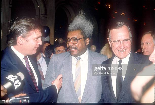 Vice President George Bush stands with Donald Trump and boxing promoter Don King April 12 1988 in New York City New York Bush and his running mate...