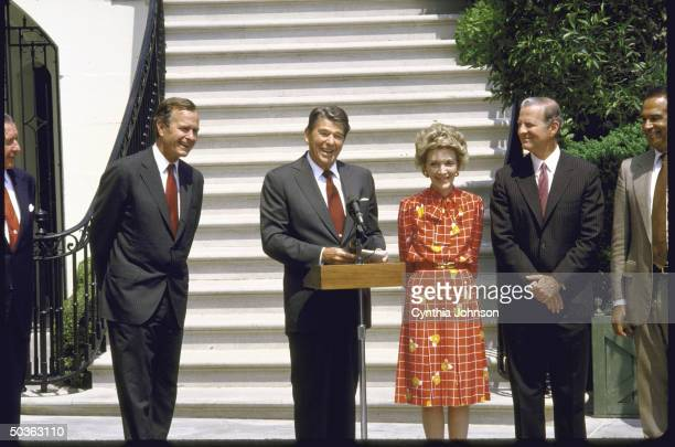 US Vice President George H W Bush President Ronald W Reagan Mrs Reagan and Treasury Secretary James A Baker III at White House welcome home ceremony
