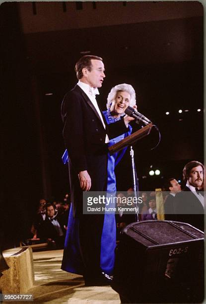 Vice President George HW Bush addresses the guests at President Reagan's inaugural ball while Mrs Barbara Bush looks on on January 20 1981 in...