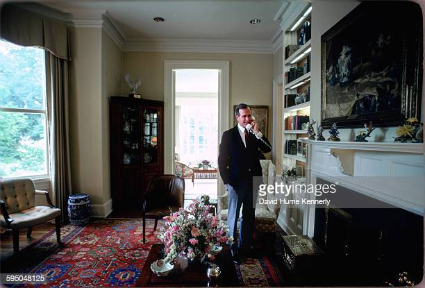 Vice President George H.W. Bush answers a phone call in the Vice President's Residence circa 1983 in Washington, DC. .