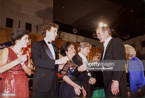 Vice President George HW Bush greets distinguished guests at President Reagan's inaugural ball on January 20 1981 in Washington DC Actress Elizabeth...