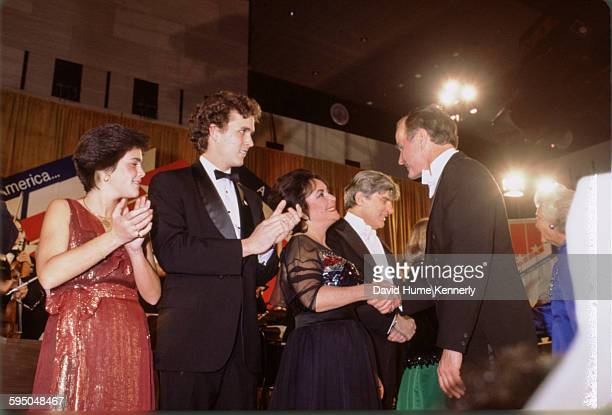 Vice President George HW Bush shaking hands with actress Elizabeth Taylor at President Reagan's inaugural ball on January 20 1981 in Washington DC To...