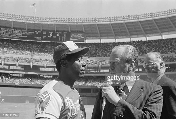 Vice President Gerald Ford presents Atlanta's Hank Aaron with his 714th career home run after the game was stopped momentarily for the presentation...