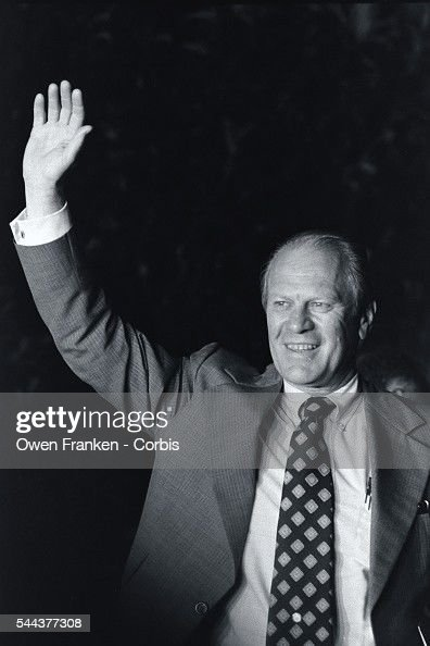 Vice President Gerald Ford waves to supporters outside of his home after the announcement that President Richard Nixon would resign office the next day. Nixon's resignation would leave Ford next in line to assume the office of the presidency.