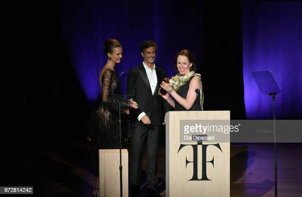 Vice President Global Fine Fragrance Dionisio 'Denis' Ferenc and Model PresenterJosephine Skriver present an award to Vice President at Puig North...