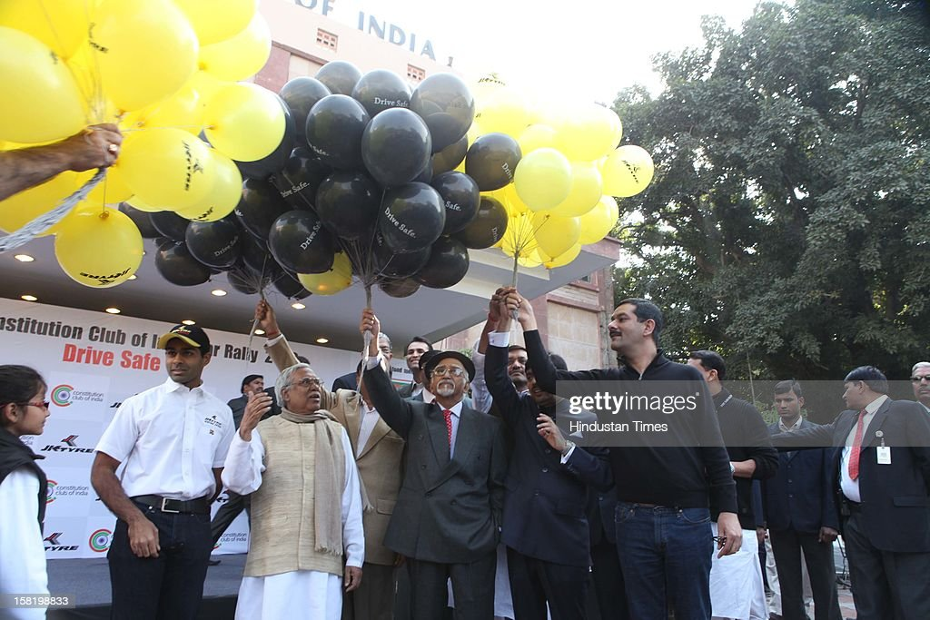 Vice President Hamid Karzai and Minister of State Sports and Youth Affairs Jitendra Singh releasing balooons in air during Vintage car rally organised by the JK Tyre and Constitution Club of India on December 8, 2012 in New Delhi, India.