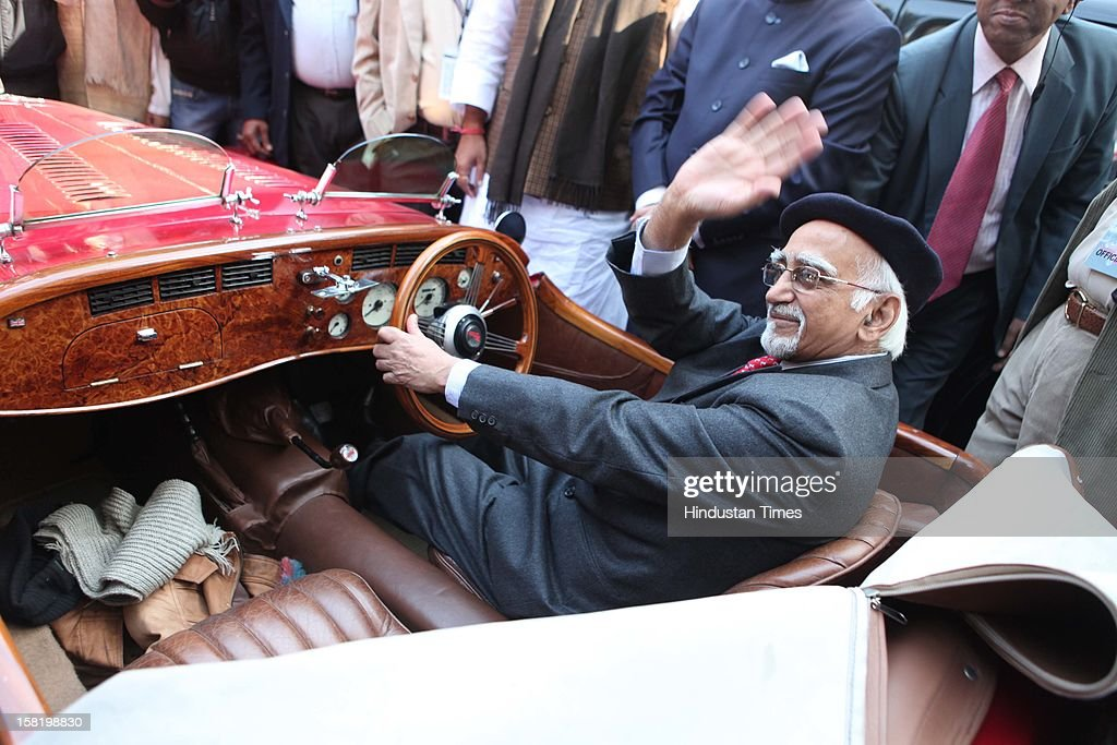 Vice President Hamid Karzai Taking trying his hands on a Vinatage car during a rally organised by the JK Tyre and Constitution Club of India on December 8, 2012 in New Delhi, India.