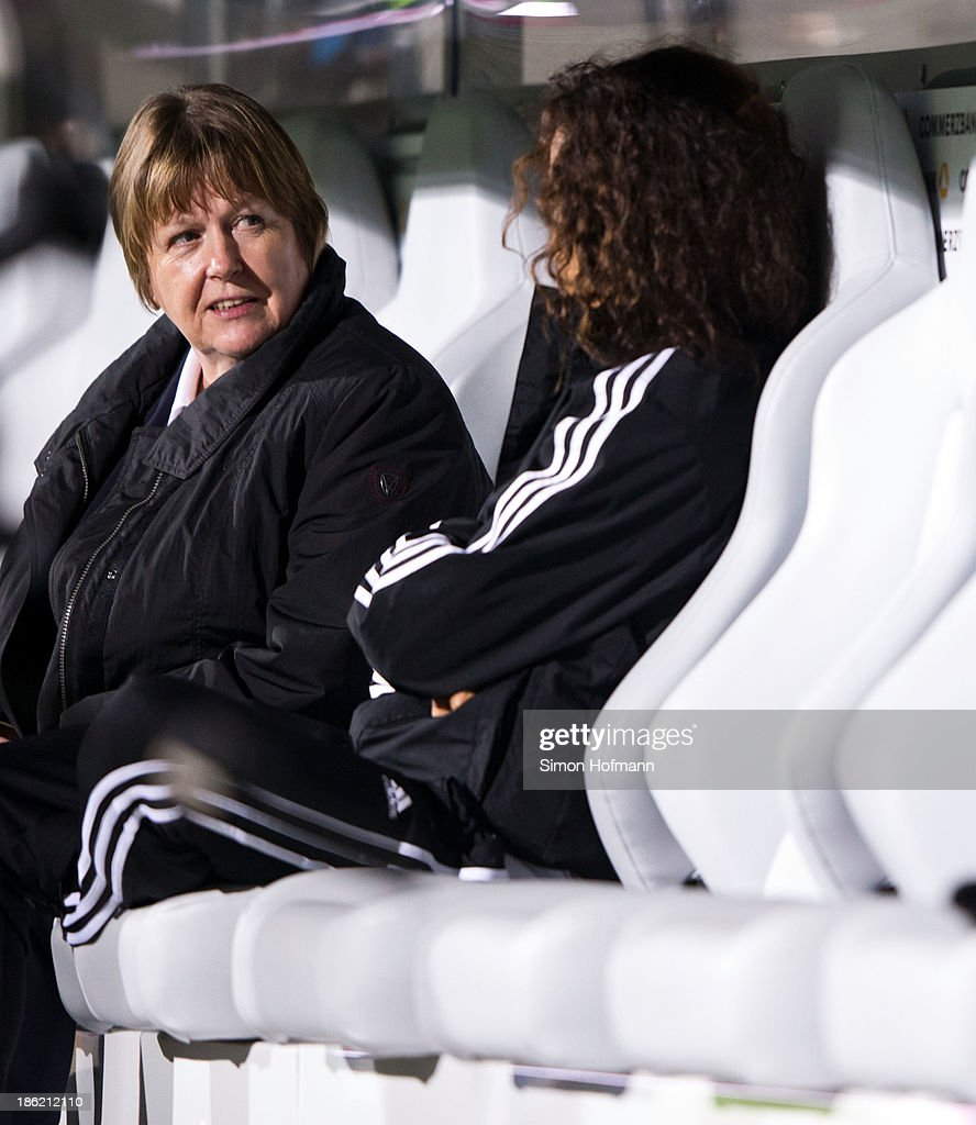 Vice President Hannelore Ratzeburg (L) talks to Fatmire Bajramaj of Germany (R) during a Germany training session at Volksbank Stadion on October 29, 2013 in Frankfurt am Main, Germany.