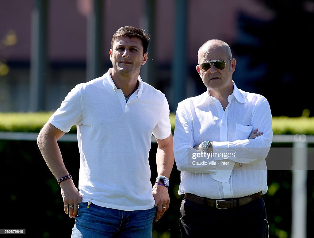 Vice President Javier Zanetti (L) and Chief Football Administrator Giovanni Gardini chat during a FC Internazionale training session on August 7, 2016 in Milan, Italy.