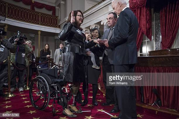 Vice President Joe Biden administers an oath to Sen Tammy Duckworth DIll during swearingin ceremony in the Capitol's Old Senate Chamber January 03...
