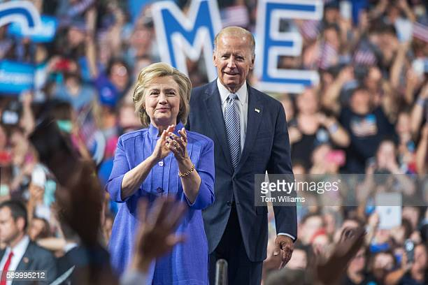 Vice President Joe Biden and Democratic presidential nominee Hillary Clinton arrive for a campaign rally at Riverfront Sports in Scranton Pa August...