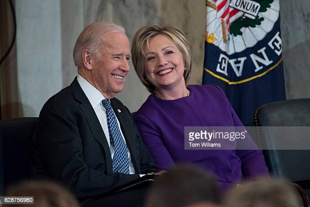 Vice President Joe Biden and former Secretary of State Hillary Clinton attend a portrait unveiling ceremony for retiring Senate Minority Leader Harry...