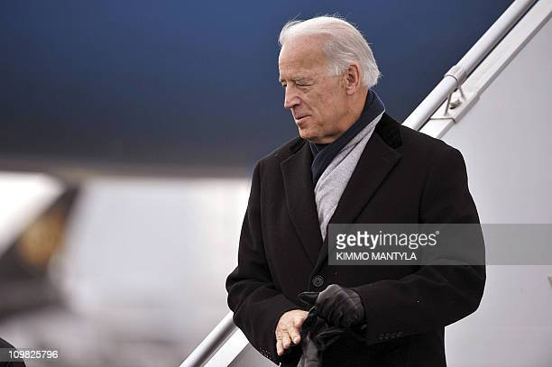 US Vice President Joe Biden and his granddaughter Finnegan arrive at HelsinkiVantaa airport on March 7 2011 Finland is the first stop of Biden's tour...