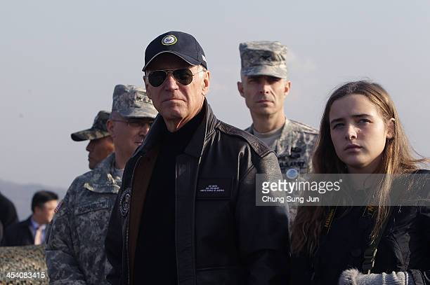S Vice President Joe Biden and his granddaughter Finnegan Biden a visit to observation post Ouellette at the Demilitarized Zone on December 7 2013 in...