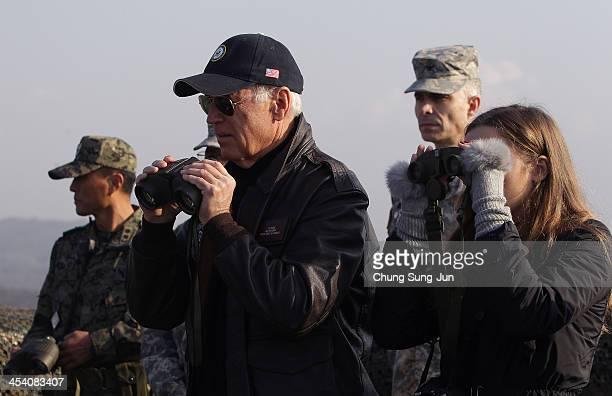S Vice President Joe Biden and his granddaughter Finnegan Biden look through binoculars toward North Korea during a visit to observation post...