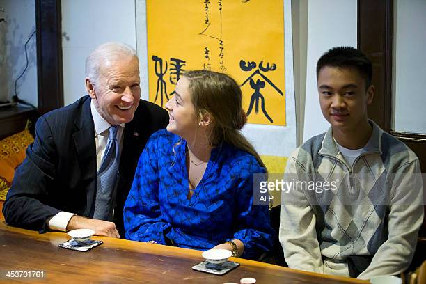US Vice President Joe Biden and his granddaughter Finnegan Biden share a light moment as they try out a Chinese tea at a tea house located along a...