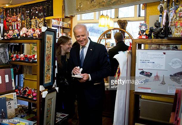 US Vice President Joe Biden and his granddaughter Finnegan Biden shop at a bookstore in Beijing on December 5 2013 Biden said on December 5 China's...