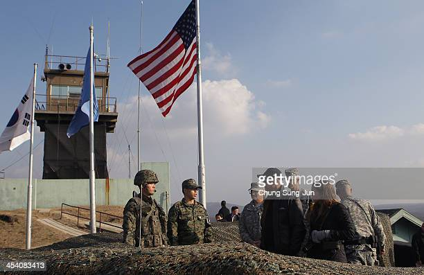 S Vice President Joe Biden and his granddaughter Finnegan Biden visit to observation post Ouellette at the Demilitarized Zone on December 7 2013 in...