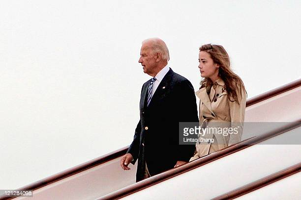 S Vice President Joe Biden and his granddaughter Naomi Biden arrive at the Beijing Capital International Airport on August 17 2011 in Beijing China...