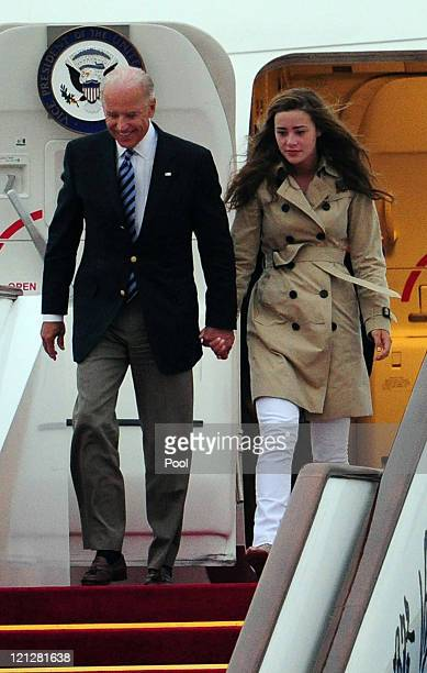 S Vice President Joe Biden and his granddaughter Naomi Biden arrive for a visit at the Beijing Capital International Airport on August 17 2011 in...