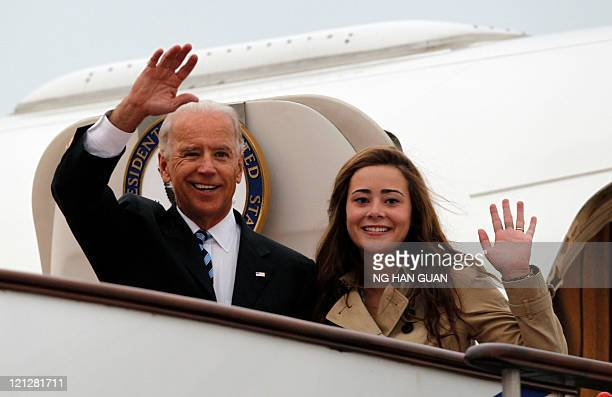 US Vice President Joe Biden and his granddaughter Naomi Biden arrive for his visit to China and Mongolia at the Beijing Capital International Airport...