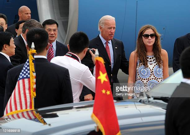 US Vice President Joe Biden and his granddaughter Naomi Biden arrive in Chengdud during his visit to China on August 20 2011 in Chengdu Sichuan...