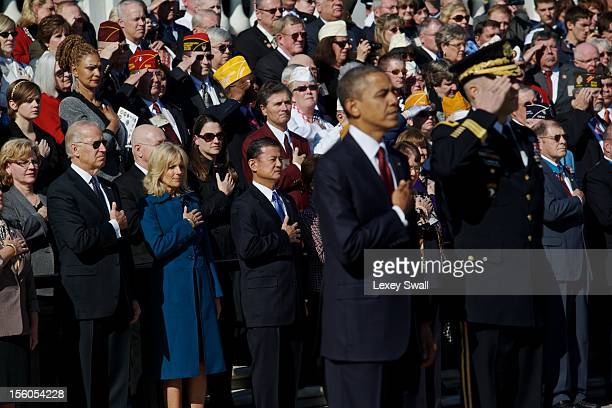 S Vice President Joe Biden and his wife Dr Jill Biden stand with their hands over their hearts for the Naitonal Anthem after US President Barack...