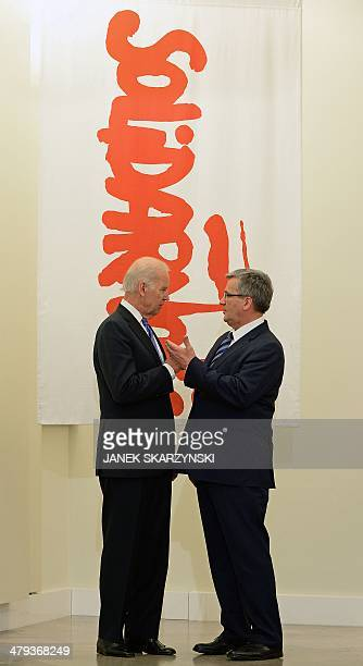 US Vice President Joe Biden and Polish President Bronislaw Komorowski talk beside the Solidarity trade union flag in the presidential palace after...