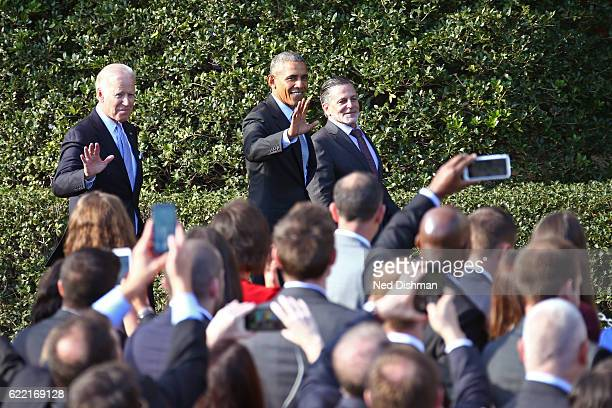 Vice President Joe Biden and President Barack Obama wave to the crowd with Dan Gilbert owner of the Cleveland Cavaliers during the visit to the White...