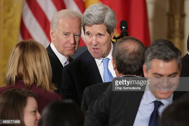 S Vice President Joe Biden and Secretary of State John Kerry talk briefly with reporters at the conclusion of a news conference by German Chancellor...