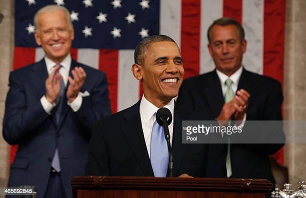 Vice President Joe Biden and Speaker of the House John Boehner applaud as President Barack Obama finishes State of the Union speech on Capitol Hill...