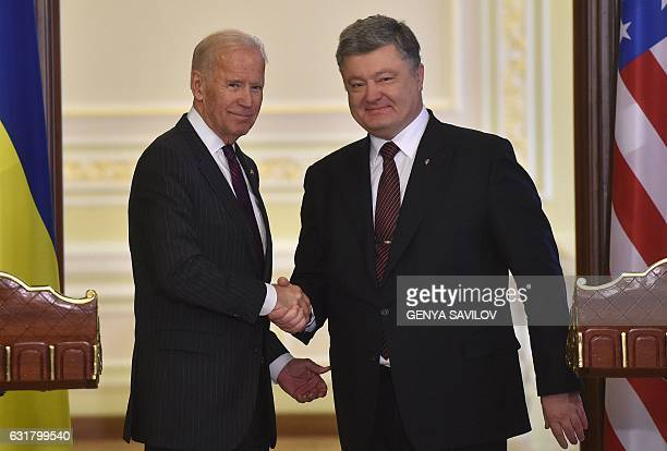 US Vice President Joe Biden and Ukrainian President Petro Poroshenko shake hands at the end of their joint press statement following their meeting in...