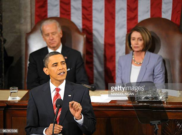 US Vice President Joe Biden and US House Speaker Nancy Pelosi listen as US President Barack Obama delivers his first State of the Union address...