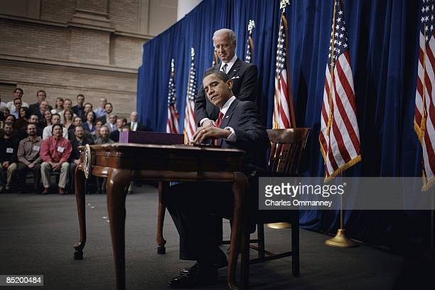 Vice President Joe Biden and US President Barack Obama sign the American Recovery and Reinvestment Act at the Denver Museum of Nature and Science on...