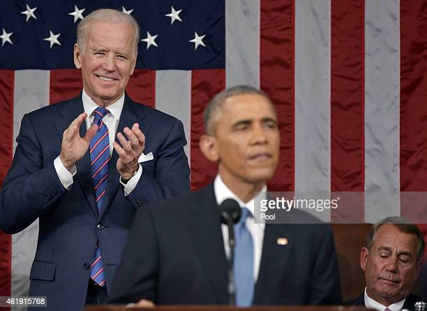 S Vice President Joe Biden applauds President Barack Obama during the State of the Union address on January 20 2015 in the House Chamber of the US...