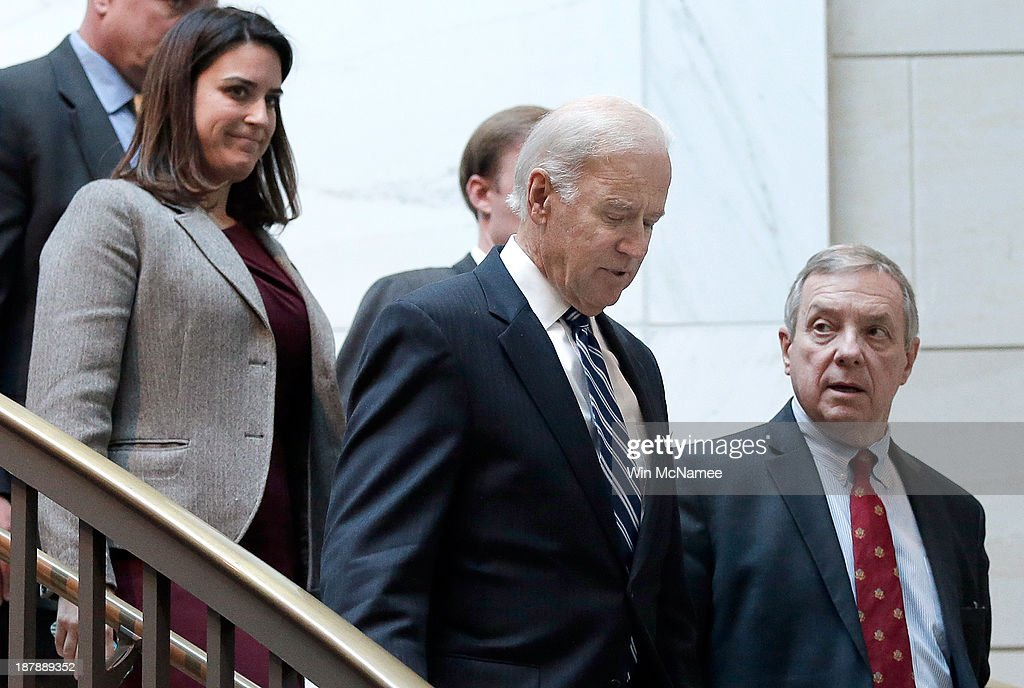 U.S. Vice President Joe Biden (2nd R) arrives with U.S. Sen. Richard Durbin (D-IL) (R) for a briefing with Senate Democratic leadership on negotiations with Iran November 13, 2013 in Washington, DC. Kerry was scheduled to brief members of the Senate on Iran and the status of the P5+1 negotiations.