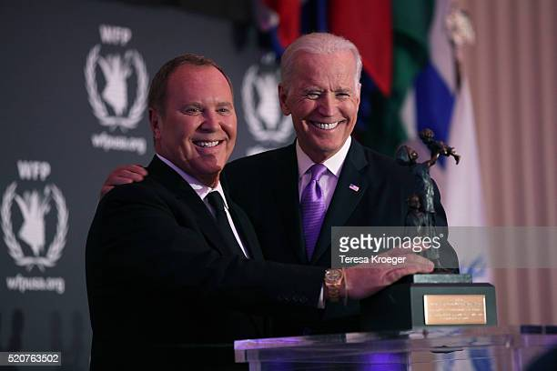 S Vice President Joe Biden awards designer Michael Kors the World Food Program USA's McGovernDole Leadership Award at Organization of American States...