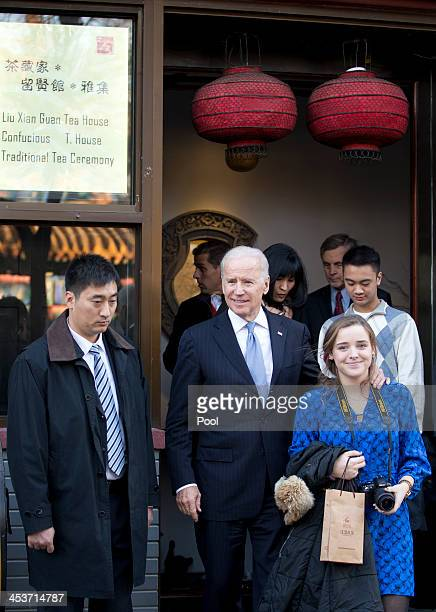 S Vice President Joe Biden center and his granddaughter Finnegan Biden right leave the tea house as they tour a Hutong alley on December 5 2013 in...