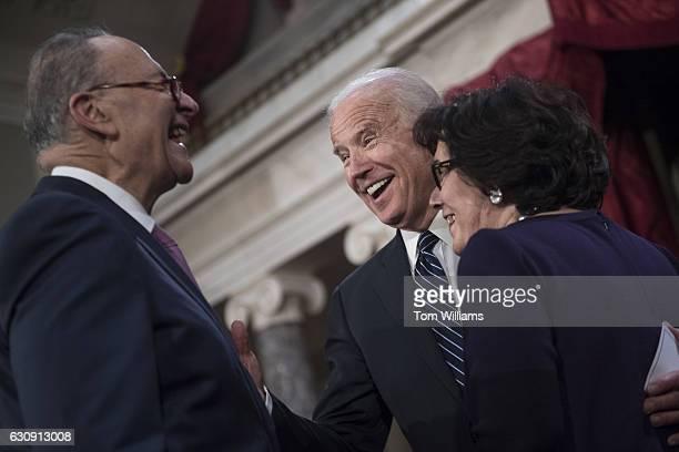 Vice President Joe Biden center greets Senate Minority Leader Charles Schumer DNY and his wife Iris Weinshall during swearingin ceremony in the...