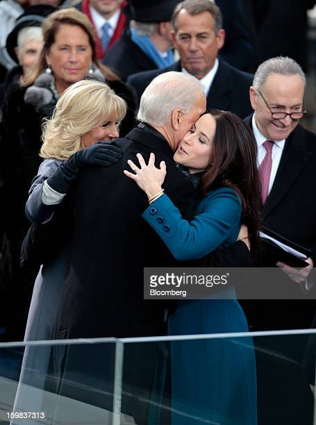 US Vice President Joe Biden center is embraced by his wife Jill Biden left and daughter Ashley Biden during the US presidential inauguration in...