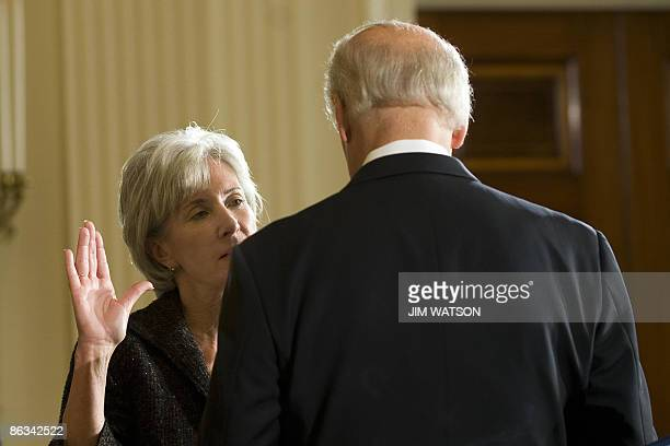 US Vice President Joe Biden ceremonially swears in Health and Human Services Secretary Kathleen Sebelius in the East Room of the White House in...