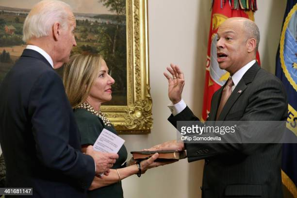 S Vice President Joe Biden ceremonially swears in Homeland Security Secretary Jeh Johnson with his wife Dr Susan DiMarco in the Roosevelt Room at the...