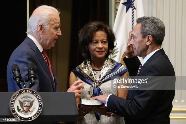 Vice President Joe Biden ceremonially swears in Mel Watt as the new director of the Federal Housing Finance Agency as his wife Eulada Watt, looks on...