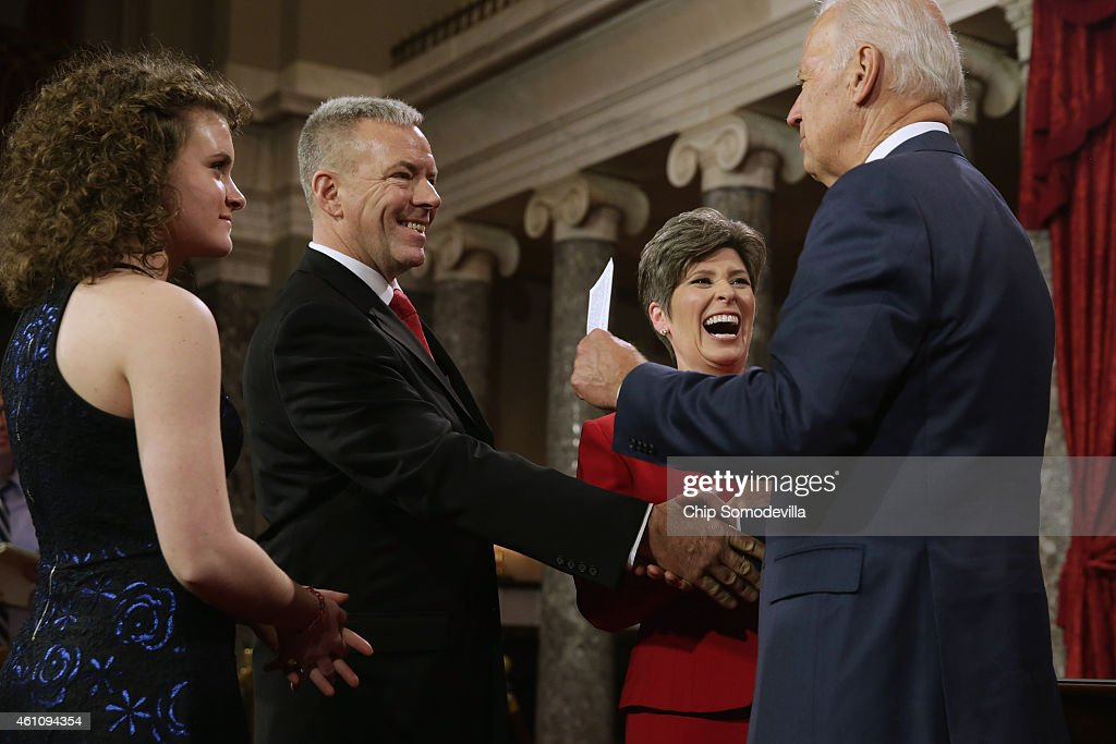 U.S. Vice President Joe Biden congratulates Sen. Joni Earnst and her family, daughter Libby Ernst (L) and husband Gail Ernst, during a cermonial swearing-in in the Old Senate Chamber at the U.S. Capitol January 6, 2015 in Washington, DC. The 114th Congress convened on Tuesday, restoring control of both the House and Senate to the Republicans for the first time in eight years.