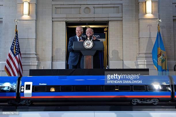 Vice President Joe Biden embraces Anthony Coscia, Chairman of the Board of Amtrak, while speaking at Amtrak's Joseph R. Biden, Jr,. Railroad Station...