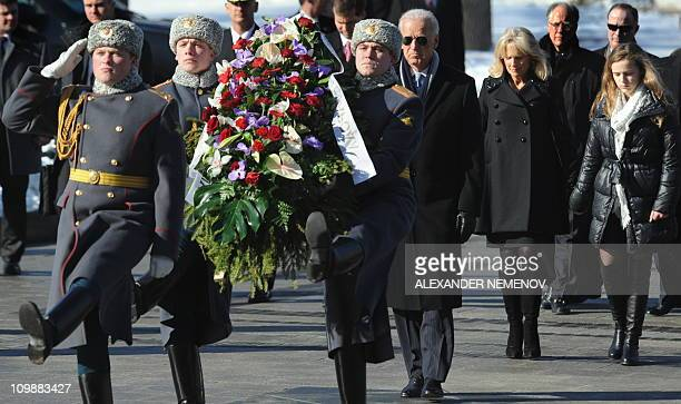 US Vice President Joe Biden folllowed by his wife Jill and granddaughter Finnegan gets ready to lay on March 9 2011 a wreath at the Tomb of the...