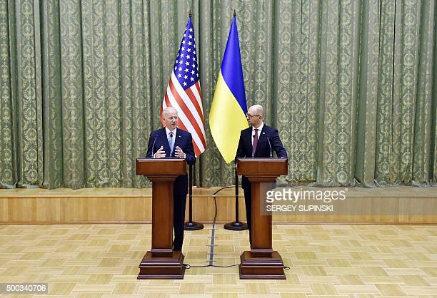 US Vice President Joe Biden gestures as he speaks next to Ukrainian Prime Minister Arseniy Yatsenyuk as they deliver a statement on the results of...