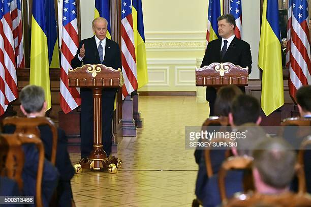 US Vice President Joe Biden gestures flanked by Ukrainian President Petro Poroshenko as they deliver a statement on the results of talks in Kiev on...