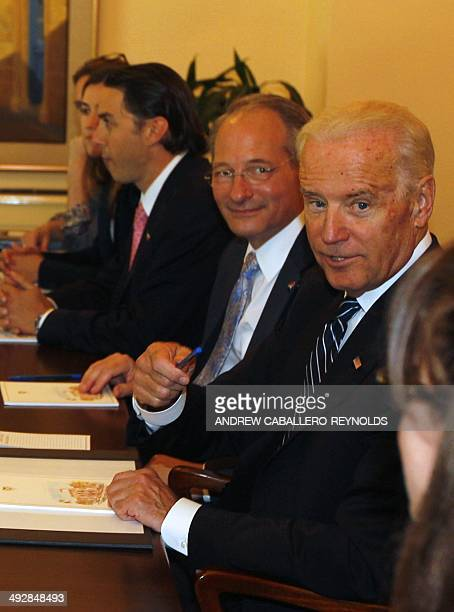 US Vice President Joe Biden gestures to someone off camera while having a meeting with Cypriot President Nicos Anastasiades on May 22 2014 at the...